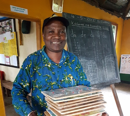 ACT Ole Supeet with the puzzles donated by Claudia van Westen